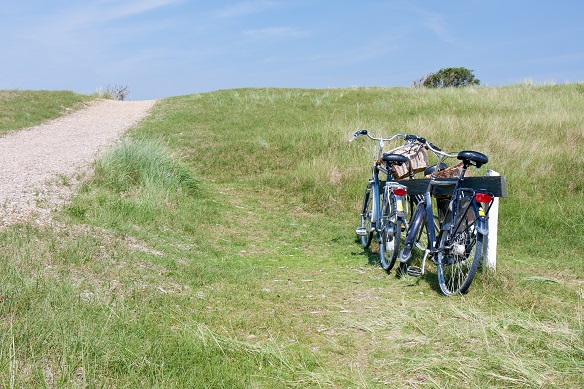 Two bicycles parked in the dunes in Netherlands.